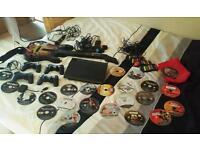 PS3 Super Slim 12GB and dozens of games, controllers etc. Inc. Buzz, Singstar, COD's, GTA 5, Fifa's