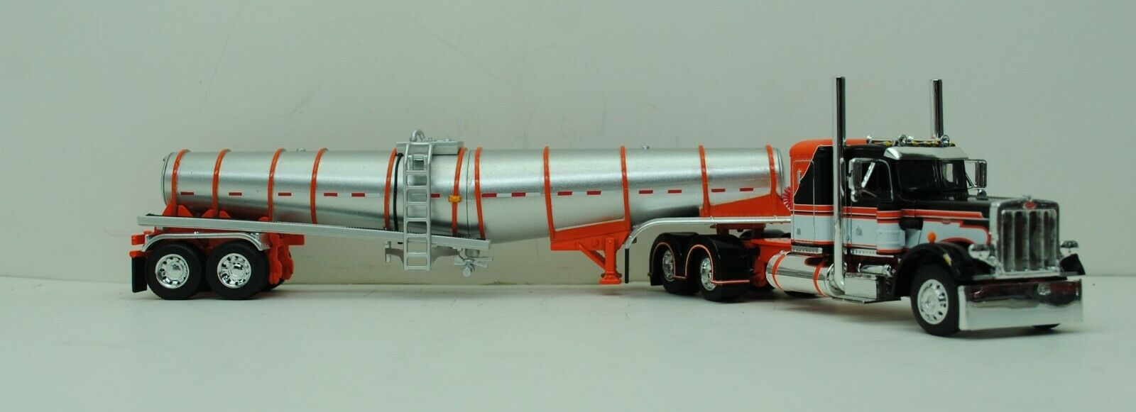 DCP 1/64 SCALE 359 PETERBILT SMALL BUNK ORANGE, BLACK, WHITE & POLAR TANKER