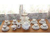 7 matching Paragon trios + not paragon ;cake stand,teapot milk and sugar bowl