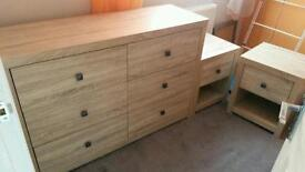 chest of drawers with two bedside table