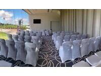 Chair covers and organza sashes/ flowers