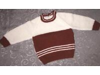 Hand knitted jumper with 3 buttons at rear
