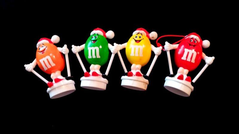"Awesome Lot Set of 4 M&M 3"" Plastic Candy Ornament Hangar Santa Hat Skiing"