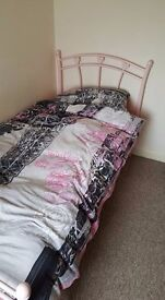 A Black and a pink single bed