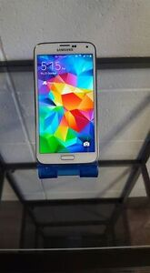 EXCELLENT CONDITION WHITE SAMSUNG GALAXY S5 ROGERS / CHATR