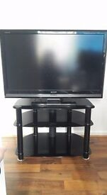 32 inch sharp TV with black glass stand