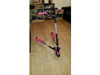 girls pink and black flicker scooter(includes helmet that hasnt been used)