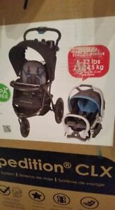 baby stroller/jogger with car seat and base.