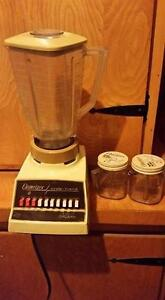 Older Blender with Extra Containers