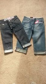 Two pair of girl's cropped jeans. Both brand new but only one pair with tags