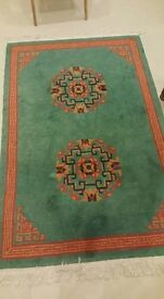 Kumbeshwar Carpets - 100% Pure Tibetan Green and Red Wool Carpet