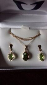 Gold chain with pendent set, with matching earrings Peridot stones inset