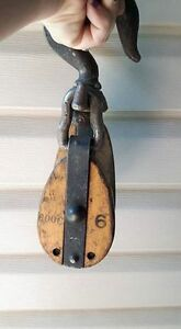 Large metal and wood pulley.