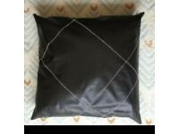 2 brand new faux black large cushions