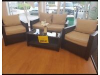 Rattan garden furniture set - sofa, two chairs and table