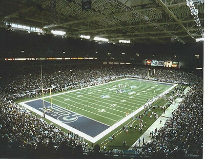 EDWARD JONES DOME ST. LOUIS RAMS 8 X 10 PHOTO WITH ULTRA PRO TOPLOADER ()