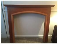 less than a year old wooden fireplace surround