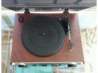 Vinyl record player with am fm radio