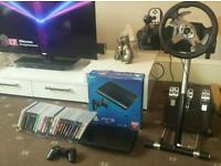 Ps3 super slim 500GB logitech G25 wheel and 28 games delivery