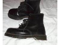 Dr.Martens black steel toe capped boots.