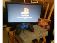 Playstation 1 with one controller and a tank game