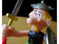 Detailed plastic models of Asterix the Gaul and his boar.