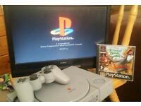 Playstation 1 with controller and game