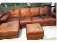 Brown chaise corner sofa and footstool