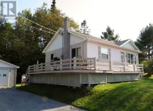 Many updates, garage, wrap around deck, great views & lot