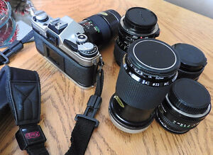 CANON AE-1 with 4extra lenses 70-150mm zoom lens , 35-70mm  zoom