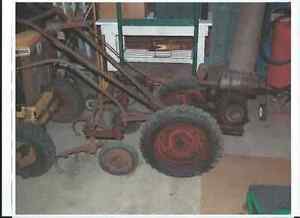 OLD  GARDEN TRACTOR  WITH  CLINTON  ENGINE .