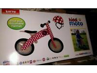 £40 as new Kurve red dotty balance bike and helmet by kiddimoto