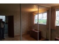 FITTED SLIDING WARDROBE mirror doors and track. Two sets: one three door and one four door.