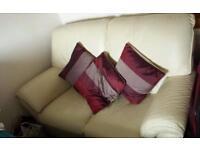 Cream colour 2 sitter sofa good condition