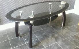 Black glass coffee table. Also have tv stand to match.