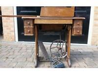 Antique singer treadle sewing machine on cast iron base