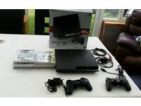Playstation 3 with 8 games 2 controllers 5m chrg wire