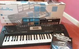 Electric keyboard and music book