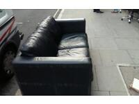 Lovely black leather sofa