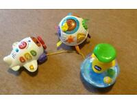 Vtech aeroplane, spinning ball and chicco ball spinning top