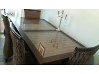 Sturdy table and 4 wicker chairs