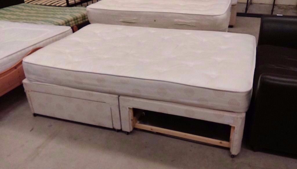 Small double bed with one missing drawer