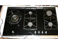 Neff 5 burner gas hob on black ceramic.