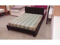 Brown leather bed frame with free sea weed mattress