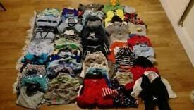 Large bundle of boys clothes 12-24m