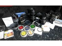 Chinon CE45 35mm SLR camera with flash gun, power driver, assorted lenses and filters - pre-owned