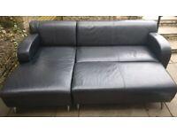 Three piece black leather sofa set