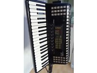 4 voice, Solton 120 Bass Piano accordion on a stand