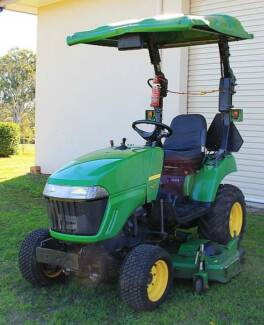 John Deere 2305 tractor with midmount 62 inch cutting deck