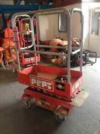 Pop Up 1.8m Platform Height Mini Scissor Lift. Perfect Working Order and Excellent Condition.